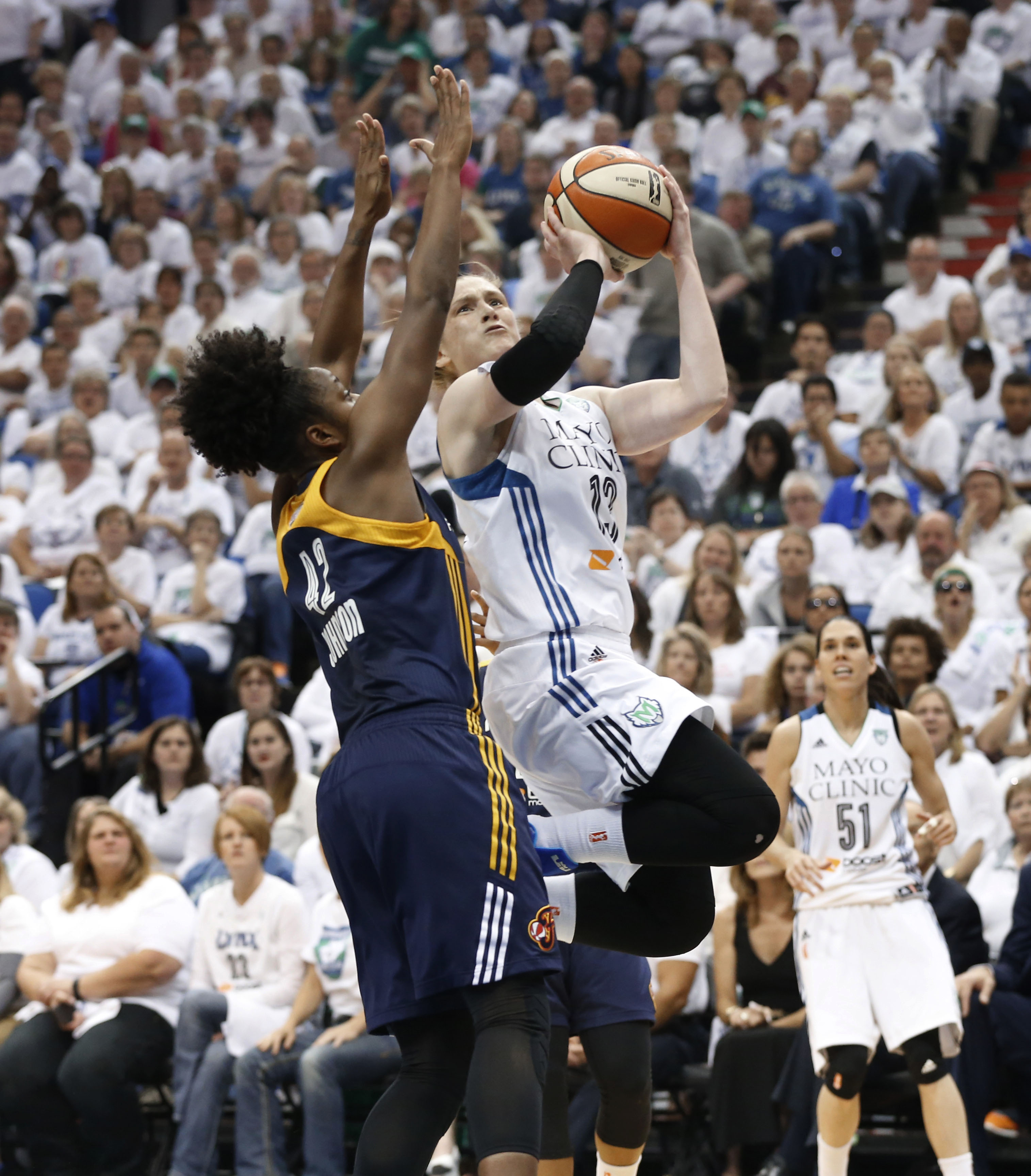 Minnesota Lynx guard Lindsay Whalen (13) drives on Indiana Fever guard Shenise Johnson (42) in the first half of Game 5 of the WNBA basketball finals, Wednesday, Oct. 14, 2015, in Minneapolis. (AP Photo/Jim Mone)