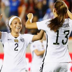 Mallory Pugh celebrates with Alex Morgan in the USA's win over Trinidad & Tobago