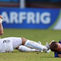 Uruguay's Luis Suarez, was banned nine matches and four months from all soccer-related activity for biting Italy's Giorgio Chiellini.