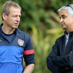 U.S. Soccer president Sunil Gulati, right, is emphatic in his approval of manager Jurgen Klinsmann, who leads the U.S. against his native Germany on Thursday.