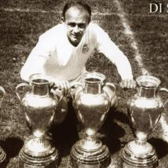 Real Madrid great Alfredo Di Stefano poses with five European Cup trophies that he won. He passed away Monday aged 88.