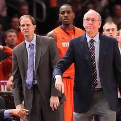 Jim Boeheim (front, right) has no plans to leave Syracuse, but when he does, his successor will likely be long-time assistant coach Mike Hopkins (front, left, blue tie).