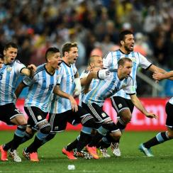 Lionel Messi, left, helps lead the celebration charge after Argentina ousts the Netherlands in penalties to reach the World Cup final.