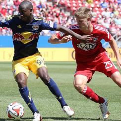 Bradley Wright-Phillips scored his MLS-leading 18th goal of the season and the 10-man New York Red Bulls beat the New England Revolution 2-1.