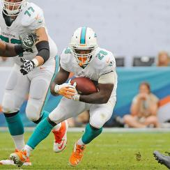 Dolphins running back Lamar Miller against the Jets in a 2013 game