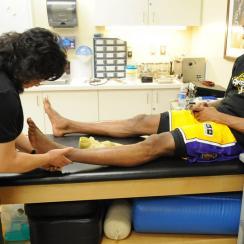 Kobe Bryant with longtime physical therapist Judy Seto.