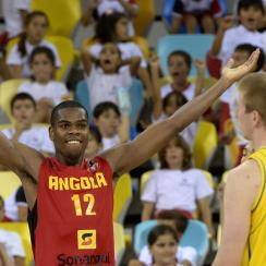 Angola center Yanick Moreira celebrates in front of Australia forward Brock Motum who had an embarrassing sequence in the third quarter.