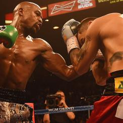 Floyd Mayweather improved his record to 47-0 with his unanimous decision victory over Marcos Madaina.