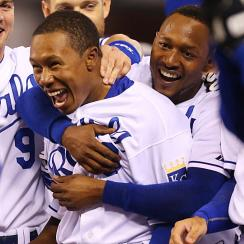 The Royals' Terrance Gore (center) receives a hug from Jarrod Dyson after Gore scored the game-winning run vs. the White Sox.