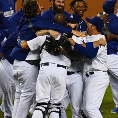The Dodgers clinched the NL West crown on Wednesday night by defeating the Giants 9-1 in Los Angeles.