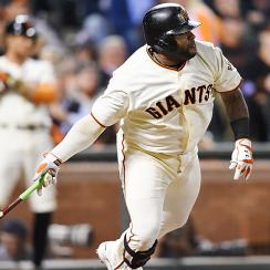 A night after losing the NL West race, Pablo Sandoval and the Giants clinched a wild-card berth when the Brewers lost to the Reds on Thursday.