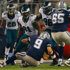 McCoy has huge day while Eagles D batters Romo in Philly's rout of Cowboys