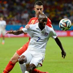 DaMarcus Beasley of the United States fights off Kevin Mirallas of Belgium during the 2014 FIFA World Cup