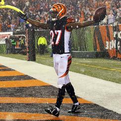 Peyton Manning's four interceptions send Cincinnati to the playoffs