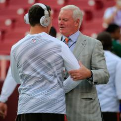 Cleveland Browns owner Jimmy Haslam speaks with Johnny Manziel before a preseason game against the Washington Redskins at FedExField on Aug. 18, 2014.
