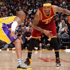 Kobe Bryant guards LeBron James