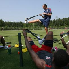 Former U.S. men's national team fitness coach Pierre Barrieu leads an exercise in May 2011.