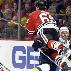 Andrew Shaw levels Barret Jackman with hit