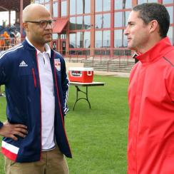 Red Bulls sporting director Ali Curtis, left, speaks with New England Revolution manager and former college teammate Jay Heaps at the MLS Combine in Florida.