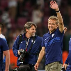 USA manager Jurgen Klinsmann waves after the USMNT beat Germany in a friendly in Cologne.