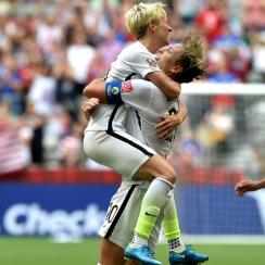 USA's Abby Wambach celebrates her Women's World Cup goal against Nigeria with Megan Rapinoe