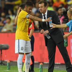 Brazil coach Dunga speaks to Neymar