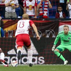 Vancouver Whitecaps goalkeeper David Ousted gets set to save a penalty kick from new York Red Bulls forward Bradley Wright-Phillips
