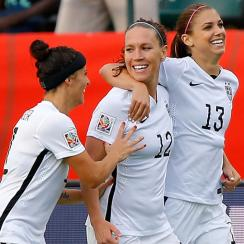 Ali Kreiger, Lauren Holiday, Alex Morgan celebrate Morgan's goal vs. Colombia for the USA