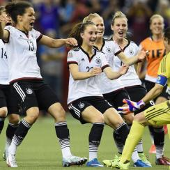 Germany mobs goalkeeper Nadine Angerer after her winning save in the Women's World Cup quarterfinals vs. France