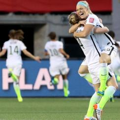 Julie Johnston and Becky Sauerbrunn celebrate after Carli Lloyd's goal in the USA's 1-0 win over China in the Women's World Cup quarterfinals