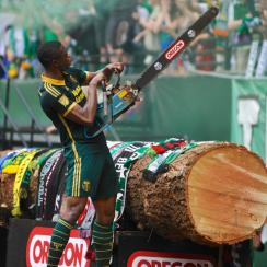 Portland Timbers forward Fanendo Adi celebrates one of his two goals vs. Seattle with a chainsaw