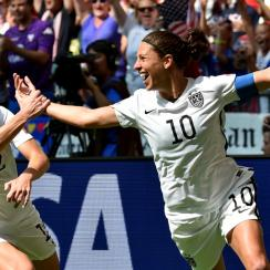 USA goal scorers Carli Lloyd, Lauren Holiday celebrate during a Women's World Cup final rout of Japan