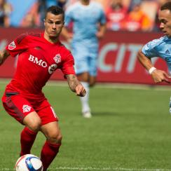 Sebastian Giovinco scored a hat trick in nine minutes in Toronto FC's 4-4 draw with New York City FC on Sunday.