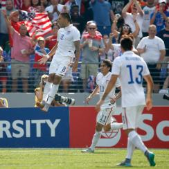 Clint Dempsey leaps after scoring one of his goals against Cuba for the USA in the Gold Cup