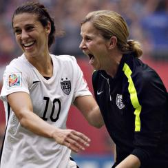 Jill Ellis and Carli Lloyd celebrate after the USA beat Japan to win the 2015 Women's World Cup