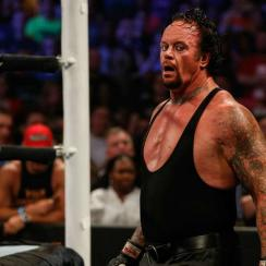 Undertaker collapses after wwe summerslam match against brock lesnar