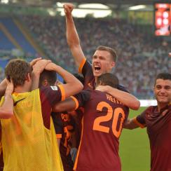 Edin Dzeko celebrates his game-winner against Juventus for AS Roma