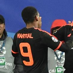 Anthony Martial, Antonio Valencia celebrate Manchester United's goal in Champions League