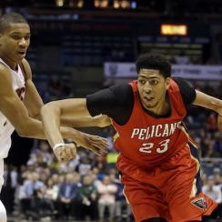 The Milwaukee Bucks' Giannis Antetokounmpo (l) tries to stop Anthony Davis (r) of the New Orleans Pelicans.