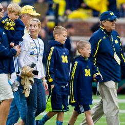Chad Carr (left, being held) and his family were honored at a Michigan game earlier this fall.