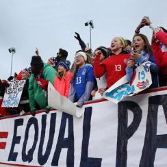 U.S. women's national team fans hang an Equal Play Equal Pay banner at a friendly vs. Colombia