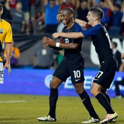 Darlington Nagbe, Christian Pulisic celebrate the USA's winning goal vs. Ecuador