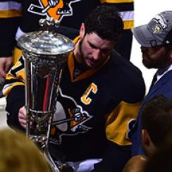 Sidney Crosby #87 of the Pittsburgh Penguins celebrate by holding the Prince of Wales Trophy after defeating the Tampa Bay Lightning in Game Seven of the Eastern Conference Final with a score of 2 to 1 during the 2016 NHL Stanley Cup Playoffs at Consol En