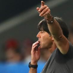 Germany manager Joachim Low apologizes for his scratch and sniff that was caught on TV