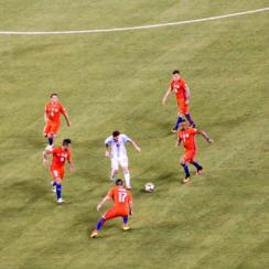 Messi is swarmed by Chilean defenders during the Copa America final