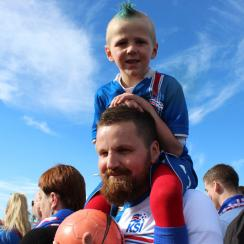 A young Iceland fan watches the Euro 2016 quarterfinal vs. France