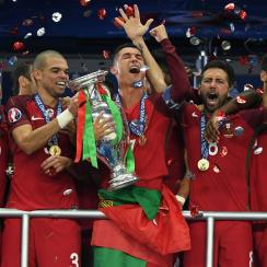 Cristiano Ronaldo lifts the Euro 2016 trophy for Portugal after an extra-time win over France in the final