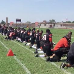 high school kneel anthem