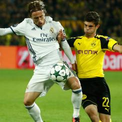 Christian Pulisic and Luka Modric vie for the ball in Dortmund's Champions League match vs. Real Madrid
