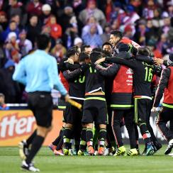 Mexico celebrates its 2-1 win over the USA in a World Cup qualifier in Columbus